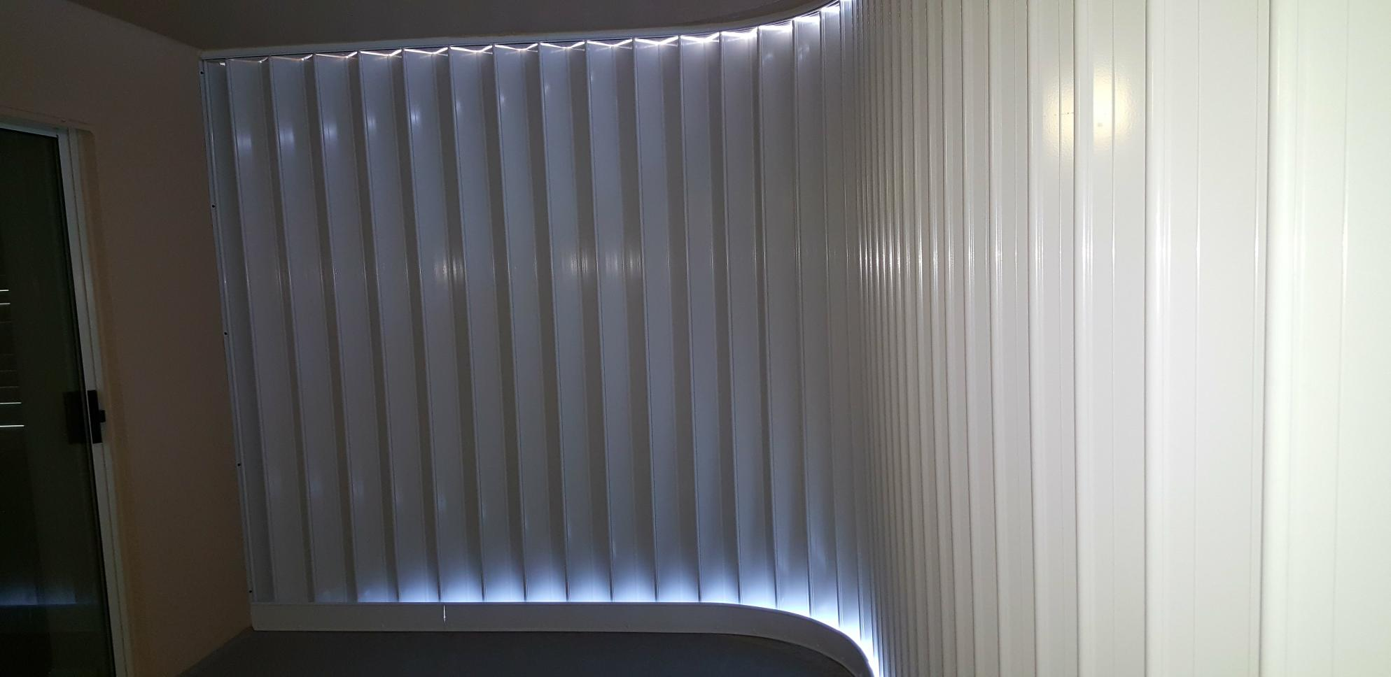 Accordion Shutters Enclose A Large Balcony Or Opening